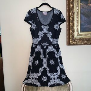 Baroque stretch knit skater dress